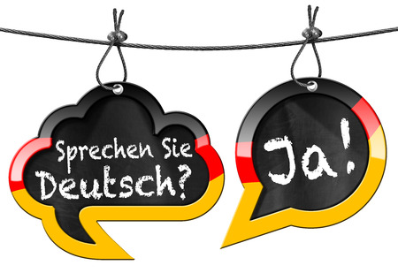 Twee tekstballonnen met Duitse vlag en de tekst Sprechen Sie Deutsch Ja! Spreekt u Duits Ja !. Op wit wordt geïsoleerd