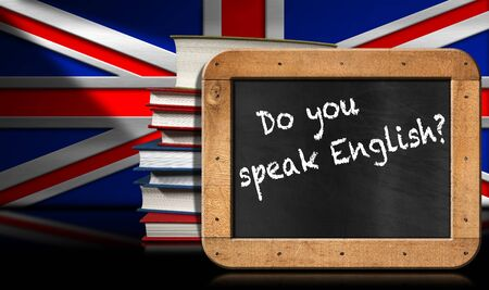 speak english: Blackboard with wooden frame and text Do you speak english A stack of books on a wall with Uk flag.