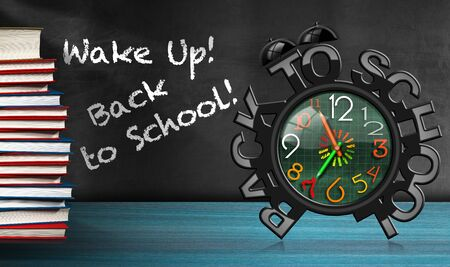 wake up: Colorful alarm clock with text Wake up! Back to school! On a desk with a stack of a books Stock Photo