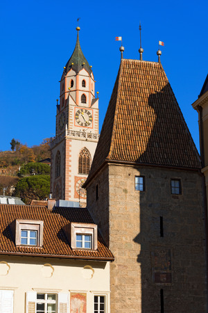 meran: Detail of the bell tower of the Cathedral and Porta Bolzano XIV century in Merano, Bolzano, Trentino Alto Adige, Italy
