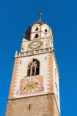 meran: Detail of the bell tower of the Cathedral of St. Nicholas 1302-1465 in Merano, Bolzano, Trentino Alto Adige, Italy Stock Photo