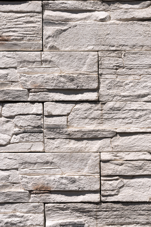 excellent background: Vertical wall with white rectangular stones makes an excellent background Stock Photo