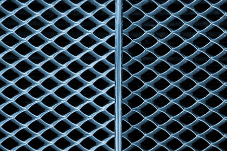 grille: Grunge metal abstract background - Detail of grille of a car