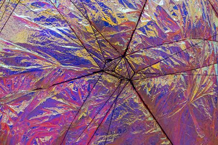 aluminum foil: Abstract background of a aluminum foil with blue, purple, yellow and red reflections