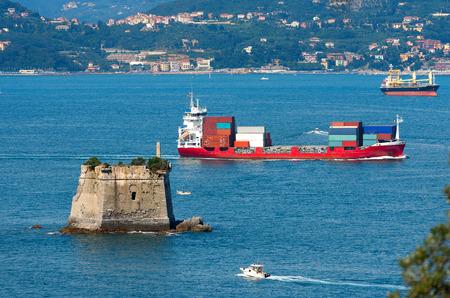spezia: Container ship in the Gulf of La Spezia or Gulf of poets Golfo dei poeti. La Spezia, Liguria, Italy Stock Photo