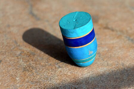 spinning top: Old wooden spinning top in motion. Trompo whipping top, Mexican typical toy Stock Photo