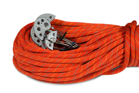 cam gear: Rock climbing equipment with two climbing cams friends and a red rope. Isolated on white background