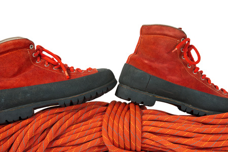 cordage: Rock climbing equipment with a pair of mountaineering boots and a red rope. Isolated on white background Stock Photo