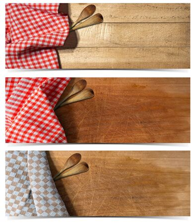 ladles: Collection of three kitchen banners with empty wooden table partially covered with checkered tablecloth and two wooden spoons or ladles. Isolated on white Stock Photo