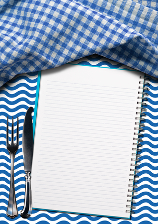 silver cutlery: Open notebook for recipes or fish menu on a background with blue and white waves, silver cutlery and blue and white checkered tablecloth