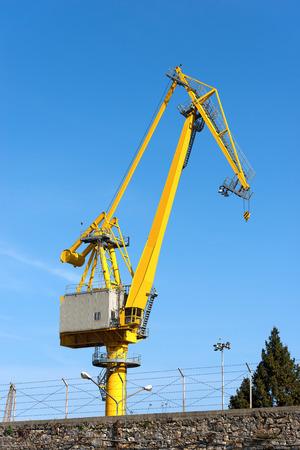 spezia: Large yellow and orange crane in the harbor of La Spezia, Liguria, Italy