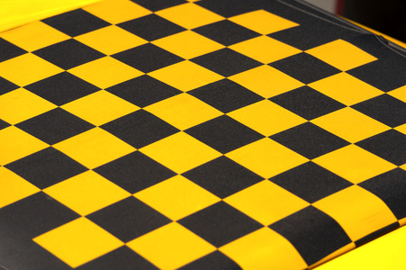sunroof: Detail of the roof of a car, yellow and black checkered. Fabric sunroof Stock Photo