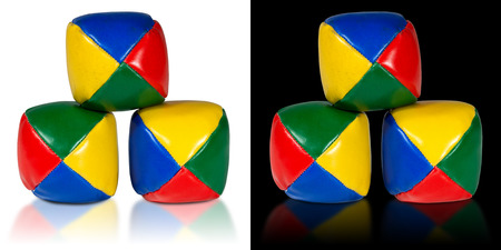 juggle: Used and colorful juggle balls, isolated on white and black background with reflections