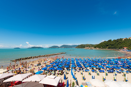 LERICI, ITALY - JULY 10, 2014: The Venere Azzurra beach, crowded with bathers on a sunny day in july. Beach between the villages of Lerici and San Terenzo in the Gulf of La Spezia, Liguria Italy