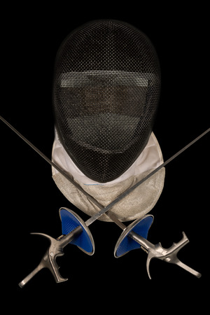 fencing foil: Fencing foil equipment. Two fencing foils with pistol grip and a fencing mask. Isolated on black background