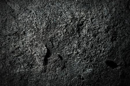 scoria: Macro photo of a black volcanic rock (volcanic bomb). Etna volcano, Sicily, Italy