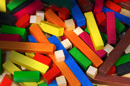 reasoning: Close up of a toy with colorful pieces of wood for creative exercises and mathematical reasoning