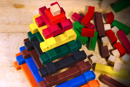 dexterity: Close up of a pyramid made with colorful pieces of wood. Toy for learn the creativity and dexterity