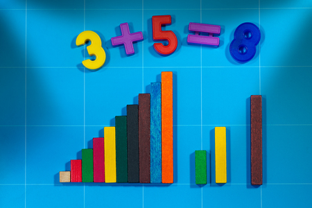 addition: Magnetic numbers with a simple mathematics addition and colorful wooden blocks for math exercises