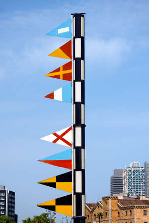 correspond: Detail of nautical flags in the Barcelona Port. They correspond to the text Port Vell, the old port of Barcelona Stock Photo