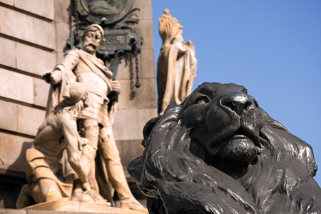colonizer: Detail of Column of Barcelona, Spain with the black lion. Monument dedicated to the famous Italian navigator Cristoforo Colombo (Christopher Columbus)