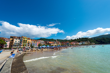 bathers: SAN TERENZO, LERICI, ITALY - JULY 10, 2014: San Terenzo (St. Terenzo) beach, crowded with bathers on a sunny day in july. The beach is located in the small village of San Terenzo, tourist resort in Lerici, in the Gulf of La Spezia, Liguria Italy Editorial