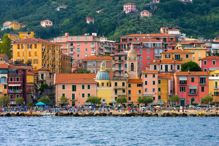 bathers: SAN TERENZO, LERICI, ITALY - JULY 28, 2014: San Terenzo (St. Terenzo) beach, crowded with bathers in a July evening. Lerici, in the Gulf of La Spezia, Liguria Italy
