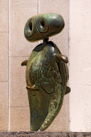 personage: BARCELONA, SPAIN - JUNE 11, 2014: Personnage (Personage) - 1970 of Joan Miro (1893-1983). The bronze statue is located at the entrance to the Museum and Foundation Joan Miro in Barcelona