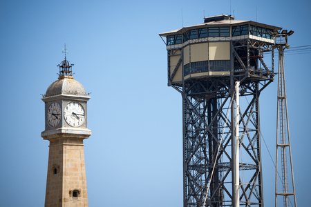 montjuic: Cable car from Barcelona in Montjuic (Barceloneta) and tower with clock (Torre del Rellotge). Catalonia, Spain