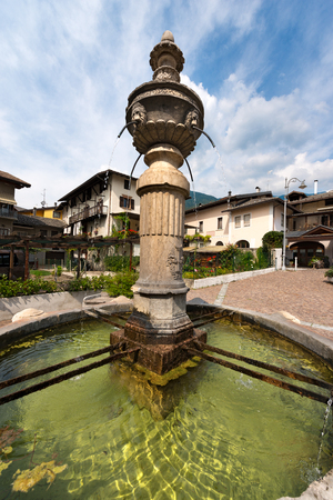 Detail of an ancient marble fountain (1553) in Levico Terme (Venezia Square), Trentino Alto Adige, Italy, Europe