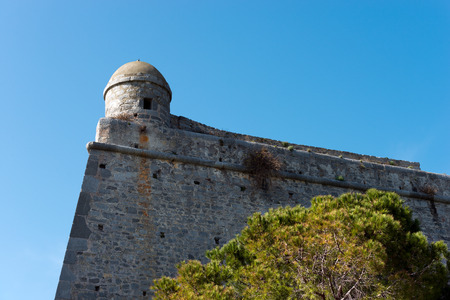 Detail of the Doria Castle (1164-XIX century) with a sentry box on a clear blue sky, in Portovenere town (UNESCO world heritage site), Liguria, Italy