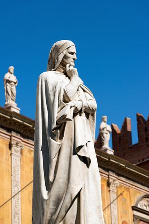 Statue of Dante Alighieri (1265-1321) father of the Italian language in Piazza dei Signori in Verona   Veneto, Italy Stock Photo