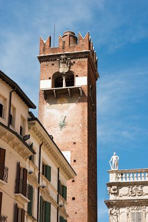 xv century: Torre del Gardello (Gardello Tower) XII century and Palazzo Maffei XV century. Piazza delle Erbe. Verona Editorial