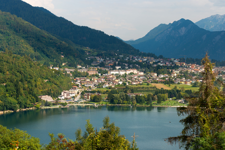 Aerial view of the small town of Levico Terme with the lake and the mountains. Trentino Alto Adige, Italy, Europe Stockfoto