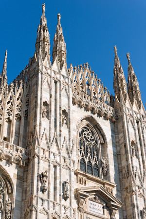 Detail of the facade of the Duomo di Milano (Milan Cathedral 1418-1577). Church monument symbol of Lombardy and of Italy. Stock Photo