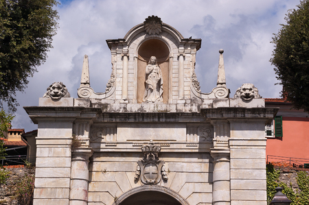 Porta Romana (Roman gate) the eastern gateway to the city of Sarzana with the emblem of the city of Genova, La Spezia, Liguria, Italy Editorial
