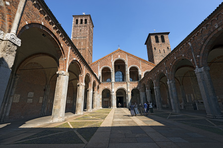 catholic nuns: MILANO, ITALY - SEPTEMBER 24, 2016: Some nuns at the entrance of the famous and ancient basilica of Saint Ambrose (SantAmbrogio 379-1099) in Milano, Lombardia, Italy