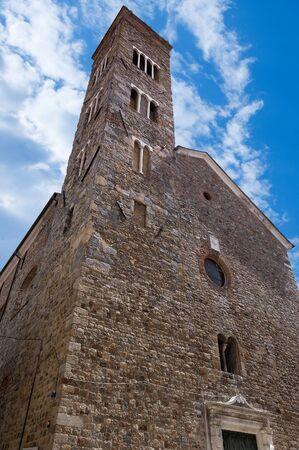 Facade and bell tower of the church of SantAndrea (Saint Andrew) X-XVI century in Sarzana, La Spezia, Liguria, Italy