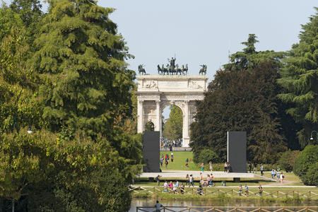 pace: MILAN, LOMBARDY, ITALY - SEPTEMBER 24, 2016: Arco della Pace (Arch of Peace 1814) in the Parco Sempione (Sempione park) is a large city park in downtown of Milan, Italy