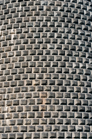 sforzesco: Detail of a rustication wall with gray stones hand carved (ashlar wall). Castello Sforzesco (Sforza Castle) Milano, Lombardy, Italy