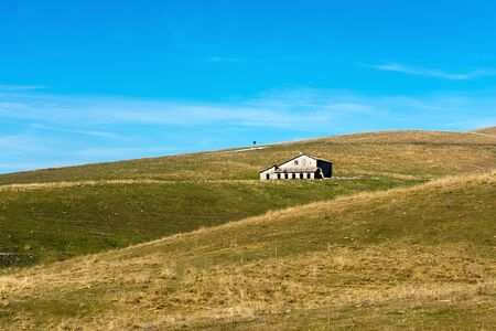 Typical farm house abandoned (Malga) in the plateau of Lessinia for the breeding of cows, Prealps of Veneto, Verona, Italy