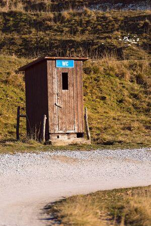 latrine: Public toilet (WC - latrine) in the Regional Natural Park of Lessinia, Plateau of Lessinia (Italian Alps), Veneto, Verona, Italy