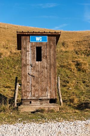 Public toilet (WC - latrine) in the Regional Natural Park of Lessinia, Plateau of Lessinia (Italian Alps), Veneto, Verona, Italy