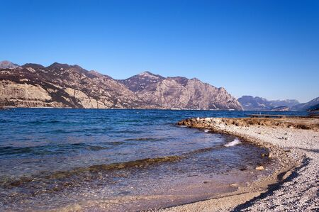 The Garda Lake in winter (Lago di Garda) with mountains near Malcesine, Veneto, Trentino, Lombardia, Italy, Europe Stock Photo