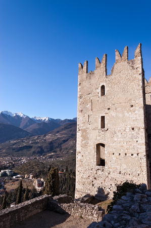 Ancient ruins of the castle of Arco di Trento (year 1000) in Trentino Alto Adige and italian Alps with snow, Italy, Europe