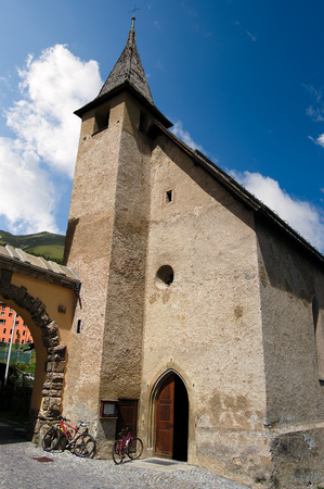 Old small church in Zuoz, small town in Engadine, Switzerland, Europe Stock Photo