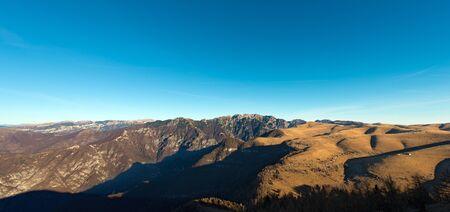 high plateau: Plateau of Lessinia, Regional Natural Park of Lessinia, Veneto, Verona, Italy. In the background the Italian Alps (Carega)