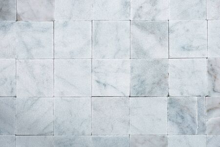 marble wall: Background with square tiles of white Carrara marble. Tuscany, Italy