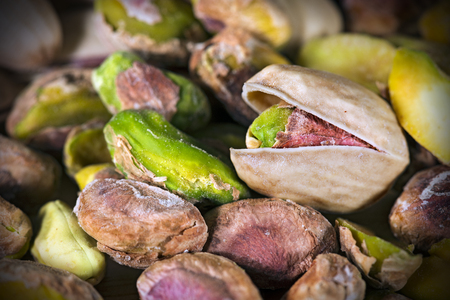 Group of roasted and salted pistachios - Macro photography Stock Photo