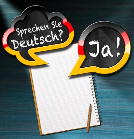 Twee tekstballonnen met Duitse vlag en tekst Sprechen Sie Deutsch? Ja! (Spreekt u Duits? Ja!). Op een bureau met lege notebook en potlood